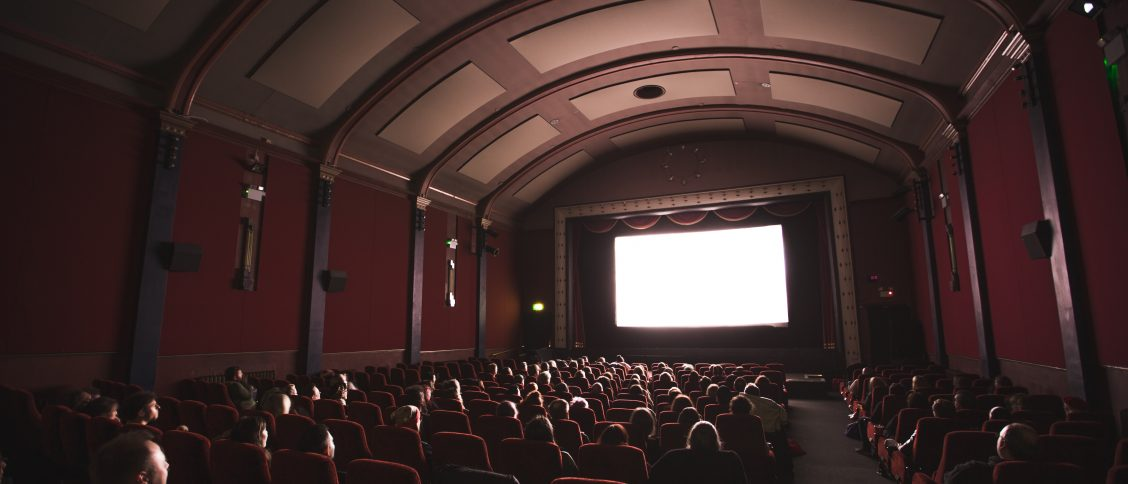 people watching movie in a cinema hall